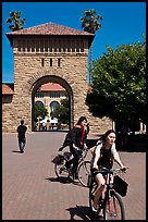Students riding bicycles through Main Quad. Stanford University, California, USA ( color)