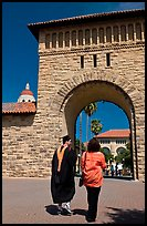 Graduate and family member walking through Main Quad. Stanford University, California, USA ( color)
