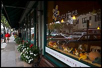 Main street reflected in storefront. Half Moon Bay, California, USA (color)