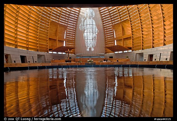 Interior reflected in Baptismal font, Oakland Cathedral. Oakland, California, USA