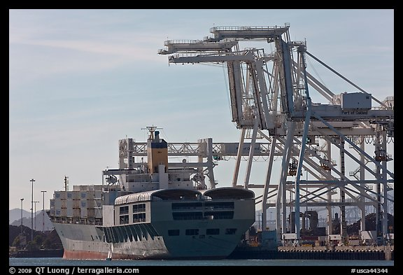 Cranes and cargo ship, Oakland port. Oakland, California, USA