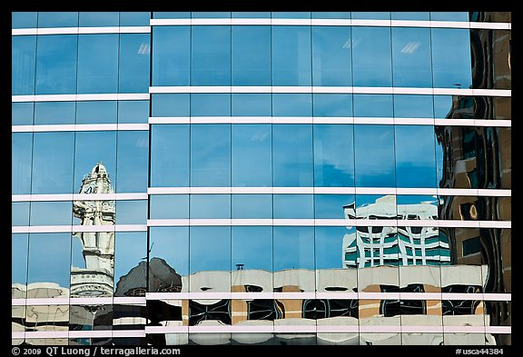 Reflections in glass buiding. Oakland, California, USA