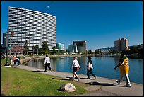 People strolling around 3.5 mile path around Lake Merritt. Oakland, California, USA