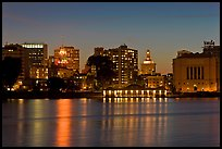 Oakland skyline reflected in Lake Merritt at night. Oakland, California, USA ( color)