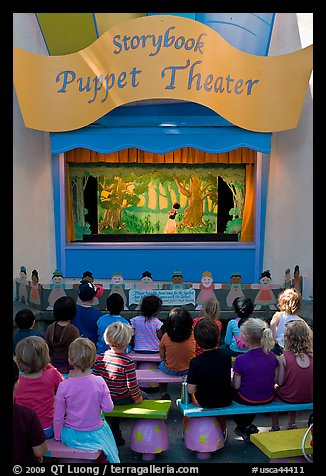 Children look at Snow white puppet show, Fairyland. Oakland, California, USA (color)