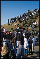 Spectators on bluff during mavericks contest. Half Moon Bay, California, USA (color)