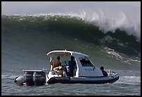 Small boat dwarfed by huge wave. Half Moon Bay, California, USA ( color)