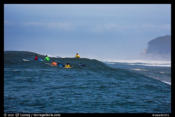 Surfers waiting for wave at Mavericks. Half Moon Bay, California, USA (color)