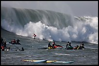 Waverunners and surfer in big wave. Half Moon Bay, California, USA