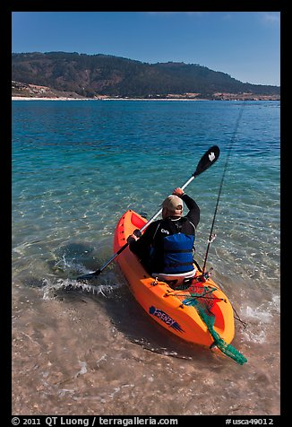 Picture photo sea kayaker with fishing rod in carmel bay for How much is a fishing license in california