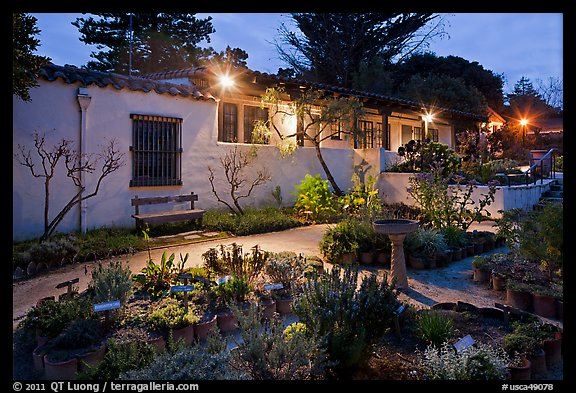 Garden and historic adobe house at night. Monterey, California, USA