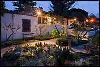 Garden and historic adobe house at night. Monterey, California, USA (color)