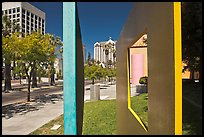 Downtown San Jose seen through colorful modern sculpture. San Jose, California, USA (color)