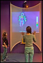 Girls play with thermal imaging camera, Tech Museum. San Jose, California, USA ( color)