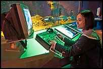 Woman controls robot, Tech Museum. San Jose, California, USA ( color)