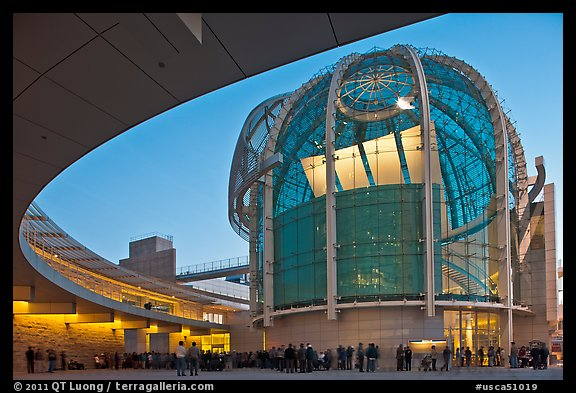 Crowd gathered around rotunda at dusk, San Jose City Hall. San Jose, California, USA (color)