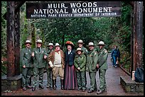 Rangers posing with Theodore Roosevelt under entrance gate. Muir Woods National Monument, California, USA ( color)