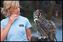 Owl perched on woman's arm, Alum Rock Park. San Jose, California, USA (color)