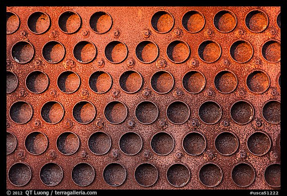 Grid of holes in metal, Shipyard No 3, Rosie the Riveter Front National Historical Park. Richmond, California, USA (color)
