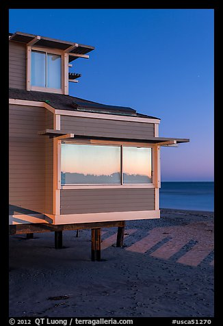 Contemporary beach house at dusk, sunset reflection, Stinson Beach. California, USA (color)