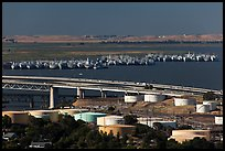 Oil tanks, Carquinez Strait, and mothball fleet. Martinez, California, USA (color)