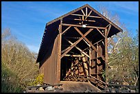 Brown truss covered bridge over the San Lorenzo River, Felton. California, USA ( color)
