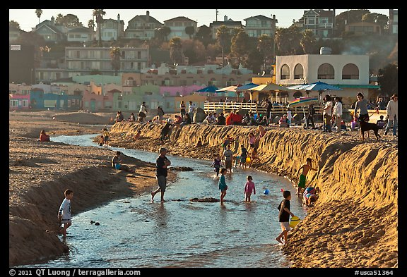 Children playing in tidal stream. Capitola, California, USA (color)