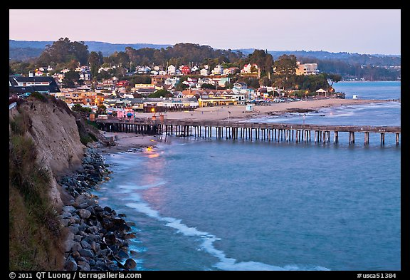 Cliff, Fishing Pier at sunset, and village. Capitola, California, USA (color)