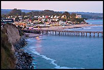 Cliff, Fishing Pier at sunset, and village. Capitola, California, USA ( color)