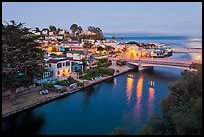 Bridges over Soquel Creek and village at dusk. Capitola, California, USA (color)
