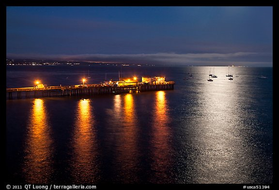Pier and yachts with moon reflection. Capitola, California, USA