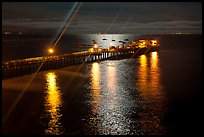 Wharf with moon reflections and light rays. Capitola, California, USA