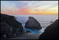 Offshore rock at sunset, Davenport. California, USA
