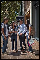 Group talking on University Avenue. Palo Alto,  California, USA (color)