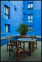 Tables and chairs in blue courtyard, Schwab Residential Center. Stanford University, California, USA ( color)