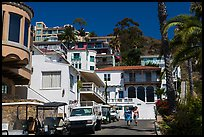 Street with hillside houses looming above, Avalon, Catalina. California, USA (color)