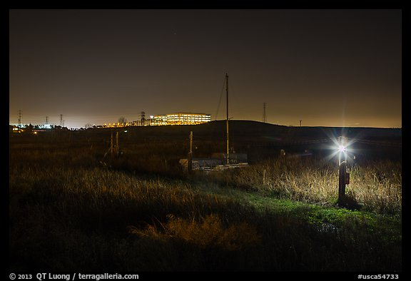 Marsh by night with office building in distance, Alviso. San Jose, California, USA (color)