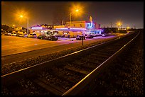 Railroad tracks and restaurant at night, Alviso. San Jose, California, USA (color)