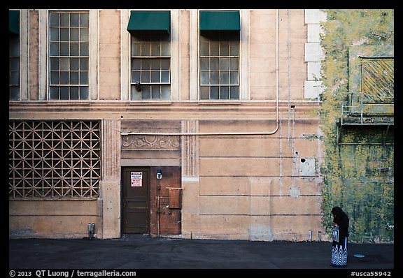 Woman standing in front of false facade, New York backlot, Paramount studios. Hollywood, Los Angeles, California, USA (color)