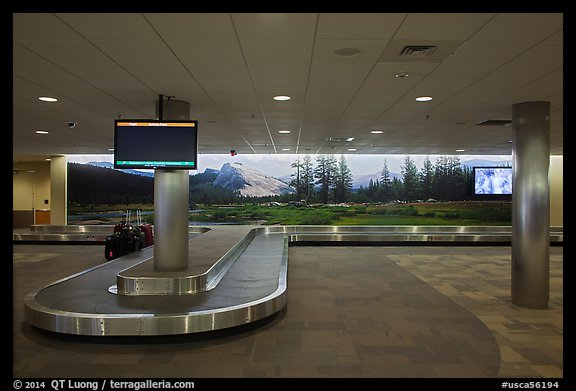 Baggage claim area and Tuolumne Meadows mural, Fresno Yosemite Airport. California, USA (color)