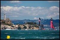 America's cup boats sail away at 40 knots from Alcatraz Island. San Francisco, California, USA (color)