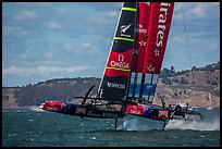Emirates Team New Zealand Aotearoa catamaran foiling in upwind leg. San Francisco, California, USA (color)