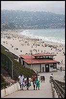 Beachgoers walking up from beach, Redondo Beach. Los Angeles, California, USA ( color)