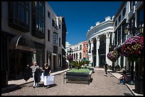 People carry garnments in  Rodeo Drive shopping district. Beverly Hills, Los Angeles, California, USA ( color)