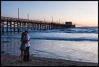 Couple embracing in front of Newport Pier. Newport Beach, Orange County, California, USA ( color)