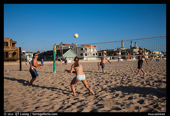 People playing volleyball on beach, Hermosa Beach. Los Angeles, California, USA (color)