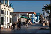 Riding bicycles on beachfront promenade, Hermosa Beach. Los Angeles, California, USA ( color)
