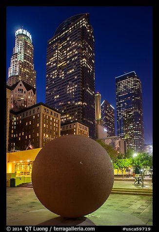 Spherical sculpture and skyscrappers at night, Pershing Square. Los Angeles, California, USA (color)