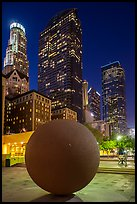 Spherical sculpture and skyscrappers at night, Pershing Square. Los Angeles, California, USA ( color)