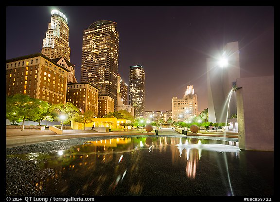 Fountain and skyscrappers at night, Pershing Square. Los Angeles, California, USA (color)